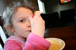 A young child eating the acorn squash soup