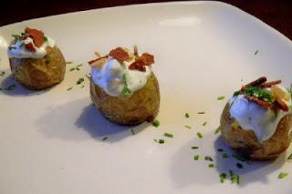 Mini stuffed potatoes served on a white plate