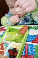 small child eating valentines day bento lucnh