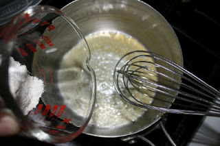 Whisking butter and added flour to cooking pot