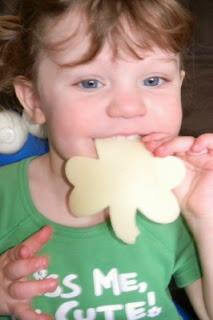 small child eating a cheese shamrock
