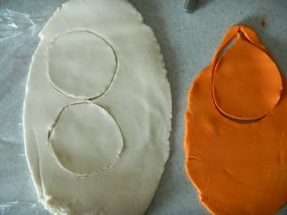 top down picture of circle shapes cut out of white and orange fondant