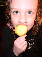child eating a yellow cake pop