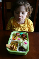 child sitting at a table looking at Tulip Bento