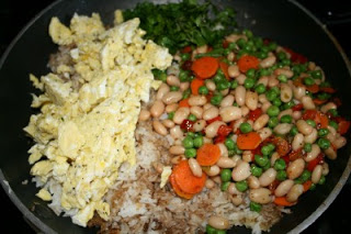 rice, sauce, chopped eggs and vegetable mixture all together in a pan