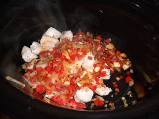cooked chicken and sauted vegetables in a slow cooker