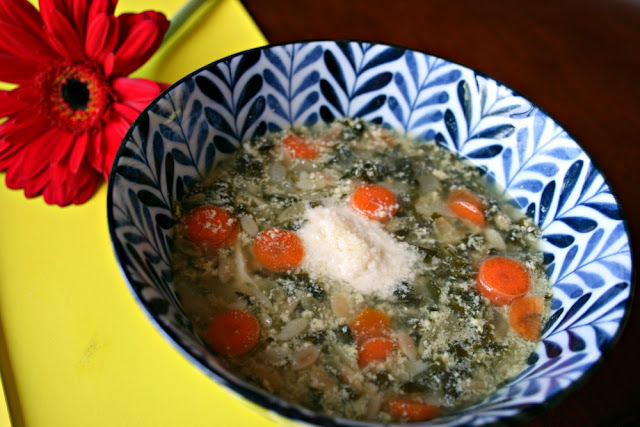 Italian Egg Drop Soup soup served in a blue and white bowl