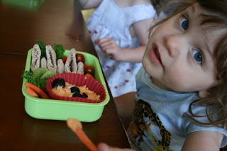small child sitting at a table with the Bento Love: Bearful Hummus Lunchbox