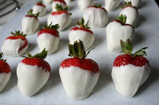 plain white chocolate covered strawberries set on parchment paper