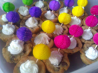 Chocolate Chip Cookie Cups with Almond Buttercream Frosting with colorful food picks inserted into center