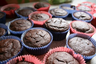 chocolate soda cupcake cooling on table