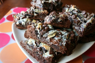 brownies stacked on a plate siting on a table