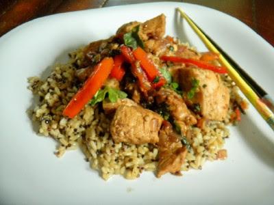 Thai Garlic & Basil Chicken served on a white plate