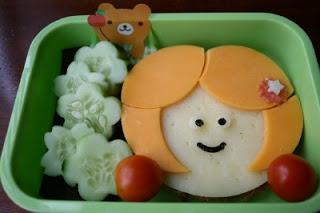 top down photo of cute sandwich that looks like a little girl