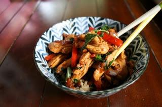 Thai Garlic & Basil Chicken served in a bowl with chopsticks