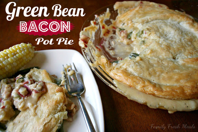 Cheesy Green Bean & Bacon Pot Pie , served on a white plate with a side of corn on the cob