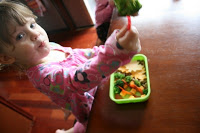 child sitting at a table eating Change of Season Lunchbox Idea