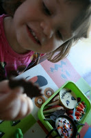 child sitting at a table looking at the Bento Love: Nightmare Before Christmas Lunchbox