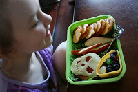 child sitting at a table with Bento Love: Trick or Treat Halloween Lunchbox
