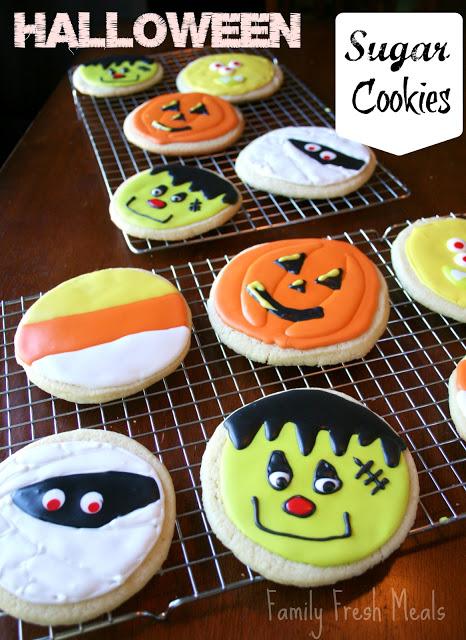 Halloween decorated sugar cookies on a cooling rack via @familyfresh