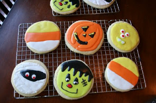 Halloween decorated sugar cookies on a cooling rack