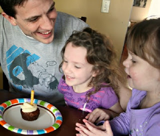 Father with 2 daughters smiling with Carrot Cake Cupcake