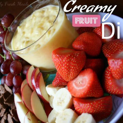 Creamy Fruit Dip served with fresh fruit on a serving platter