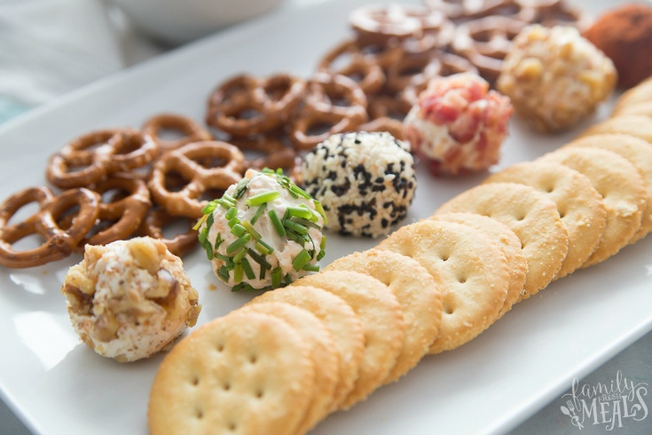 Mini Cheese Balls - mini cheese balls served on a plate with crackers and pretzels