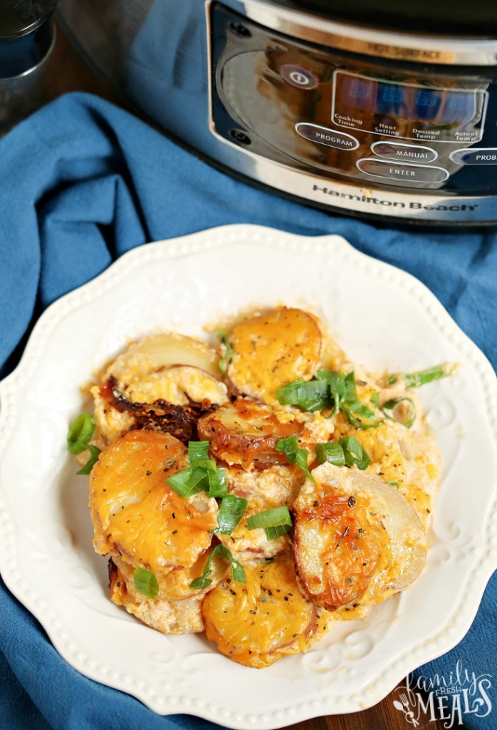 Slow Cooker Scalloped Potatoes served on a white plate