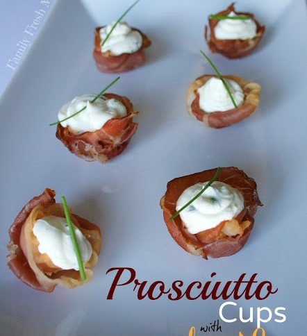 Prosciutto Cups with Cheese & Herb Filling served on a white plate