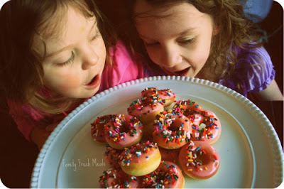 Mini Baked Donuts on a platter with 2 children looking at them