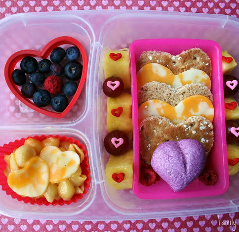 Top down picture of lunch box filled with heart shaped food