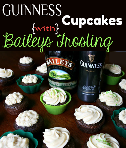 Guinness Cupcakes set out on a table with a bottle of Guinness Bear and Bailey's