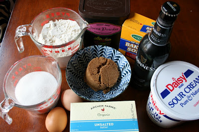 Ingredients for Guinness Chocolate Cupcakes with Baileys Cream Cheese Frosting on a table