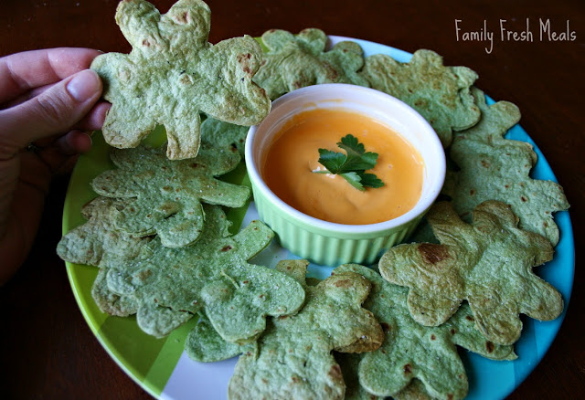 EASY Homemade Tortilla Chips served on a plate with cheese dipping sauce