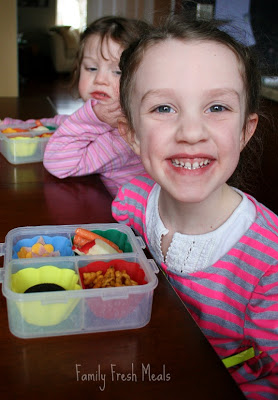 2 children sitting at a table with Spring Snack Lunch Box
