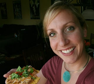 woman holding a tostada