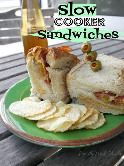 Slow Cooker Sandwiches served on a green plate with potato chips