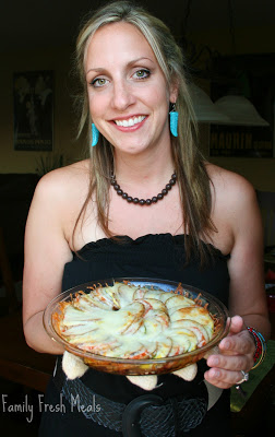 woman holding cooked Vegetable Pie