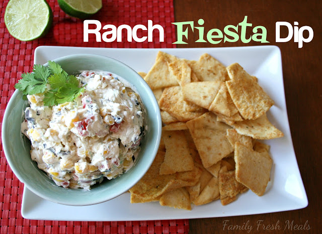 Ranch Fiesta Dip served in a bowl with a side of pita chips