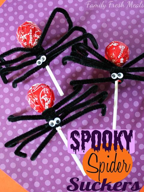3 Suckers spider crafts on a purple piece of paper