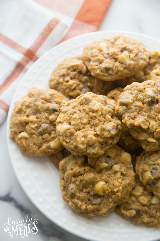 Pumpkin Oatmeal DOUBLE Chocolate Chip Cookies stacked on a white plate