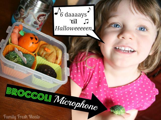 child sitting at table with halloween themed lunchbox. Speech bubble coming from her mouth saying 6 Daaaaaaays 'til Halloweeeeen