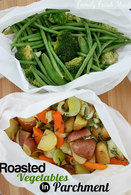 Top down image of two different sets of mixed vegetables in parchment packets