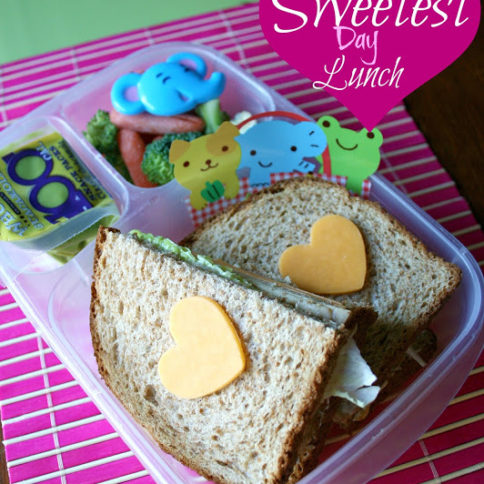 Sandwich with cheese hearts on top of bread, in a lunchbox