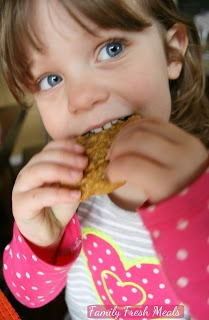 child eating a Pumpkin Oatmeal DOUBLE Chocolate Chip Cookie