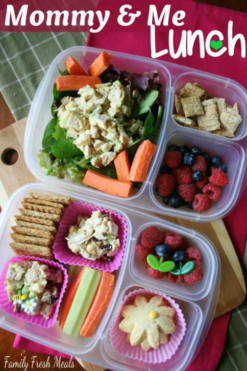 Top down image of 2 lunchboxes with curry chicken salad