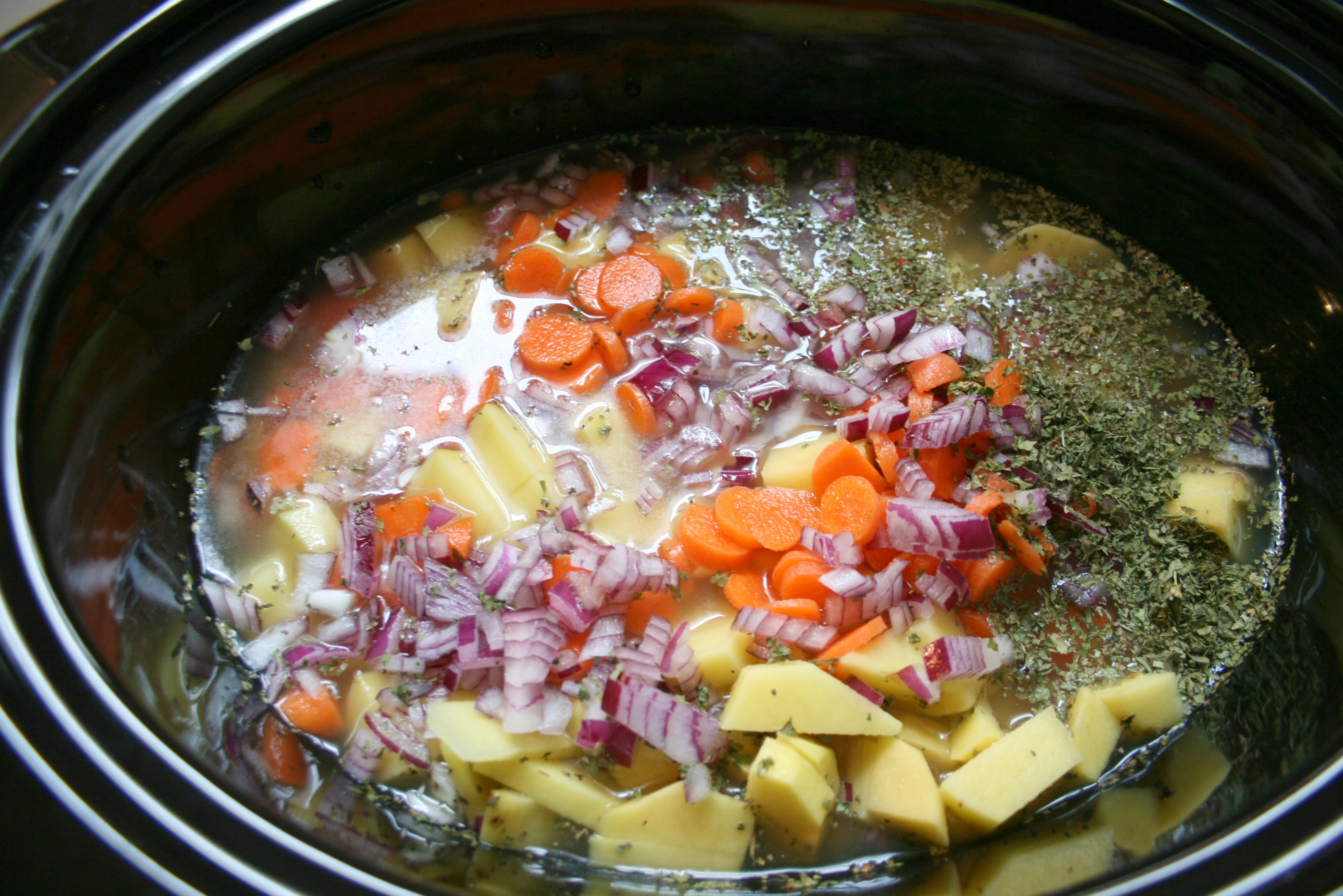 place vegetables in crockpot