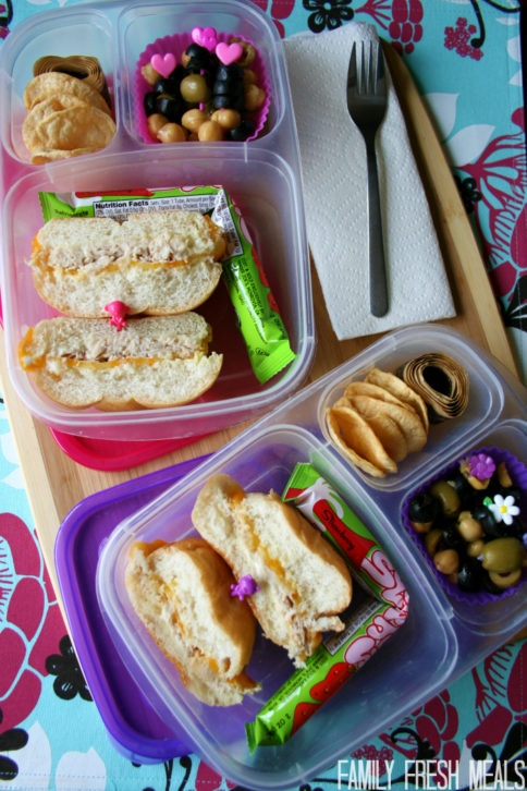 Bean and olive salad packed in a lunchbox with sandwich