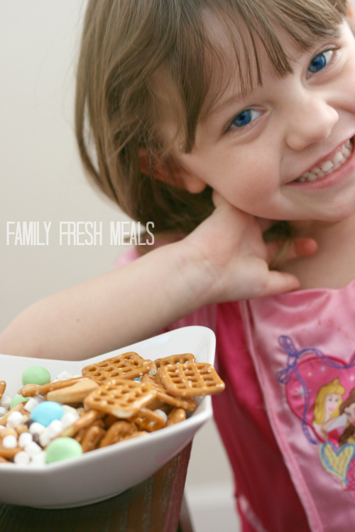 Child smiling next to a bowl of bunny bait
